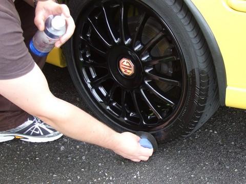 Applying Mark V California Dressing using a split applicator to the tyre.
